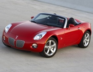 a pontiac solstice convertible in cherry red.... Just for me...  BMW instead... even better   4/14/2012