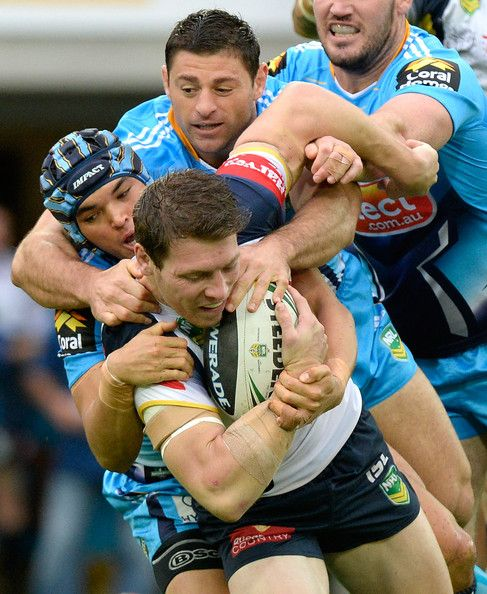 Rory Kostjasyn of the Cowboys is tackled during the round 12 NRL match between the Gold Coast Titans and the North Queensland Cowboys at Skilled Park on June 2, 2013 in Gold Coast, Australia.