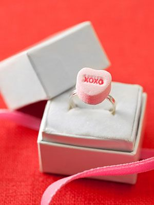 FUN but lasts about a day  Materials • Hot-glue gun and glue  • Conversation heart candy  • Plastic or metal ring •• Directions    1. Apply a dab of hot glue to the back of a conversation heart candy. Press the ring into the glue; let dry.