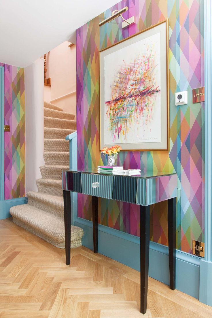 Colourful hallway with a glamorous feel. The Pink House basement hallway with Cole & Son Prism wallpaper.