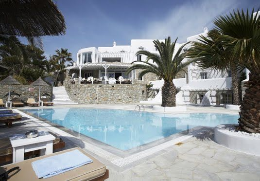 A boutique five-star hillside retreat in Mykonos with romantic interiors - includes breakfast, dinner and transfers