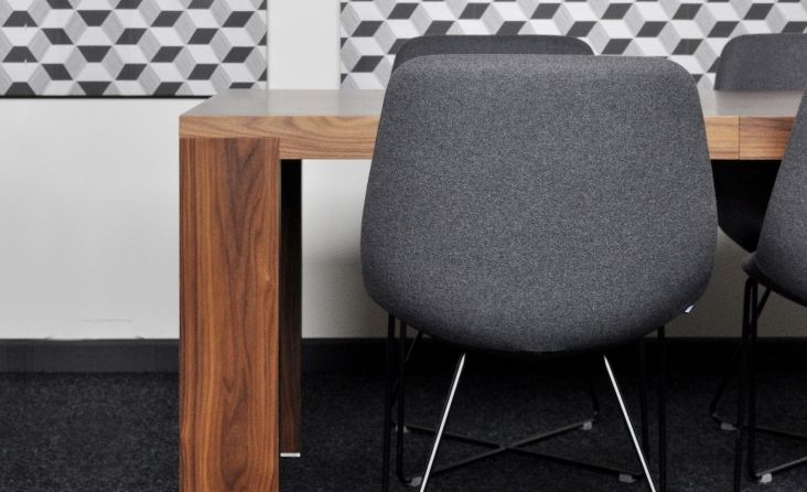 One of many Mishell chair designes at Noti. Upholstered in dark grey Wool fabric from Dekoma.