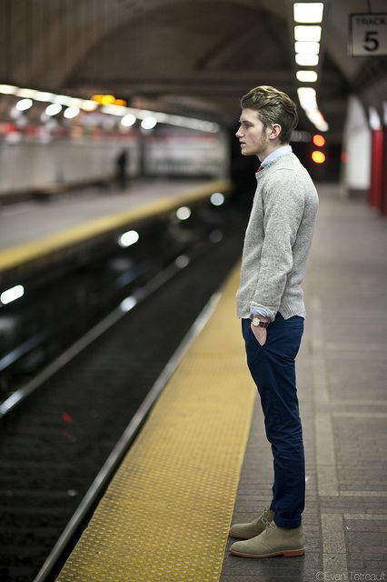 Look dapper in Grey Sweater, White Shirt, Navy Chinos and a pair of Olive Suede Desert Boots