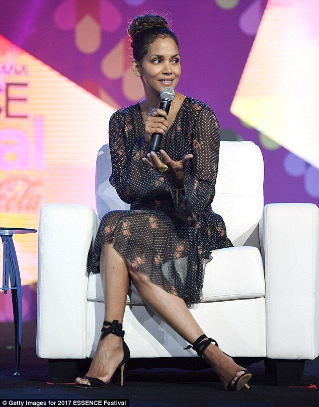 Stunning speaker: Halle Berry, 50, was spotted on stage at the Essence Festival on Friday