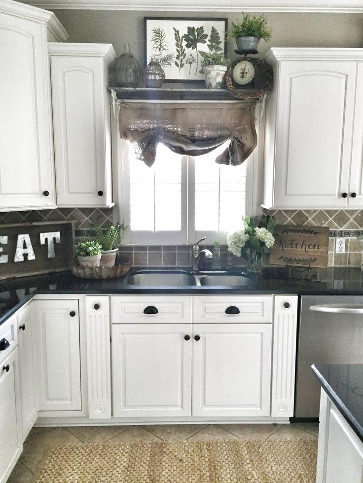 Farmhouse kitchen decor. Shelf over sink in kitchen