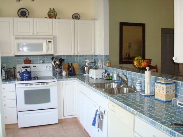 blue kitchen white appliances white and blue tiled