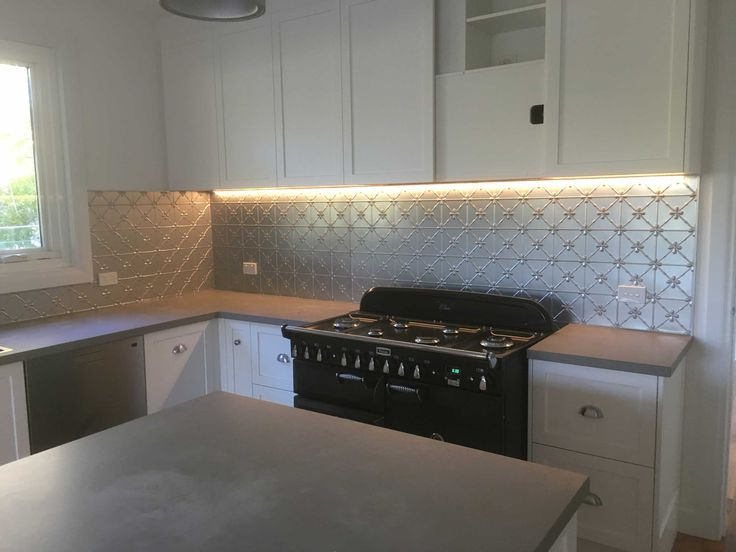 Our client Kaye was determined to have a pressed metal splashback in her kitchen but just couldn't decide on a colour until we sent her home with a sample of Frontline Silver.  This metallic powdercoat has little flexs of silver that catch the light.  Doesn't it look perfect in her kitchen. For sizing and pricing go to: www.perioddetails.com.au