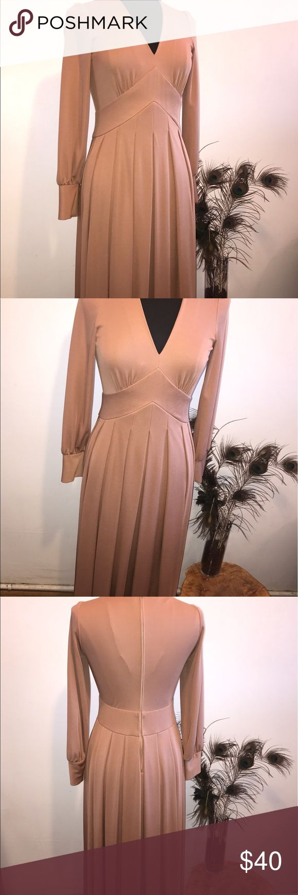 "***VINTAGE*** Gorgeous 70's/80's Nude Long Dress **VINTAGE*** Gorgeous 70's/80's Nude Long Pleated Dress, no tags but fits like a S/M. How do I know it's vintage, because it's my grandmas & she keeps her higher end clothing in great condition, zipped up in wardrobe bags! This dress has great details! Probably 100% polyester, well made & well kept. This is a true gem, I call it ""Dancing Queen""! 💃 Dresses Long Sleeve"