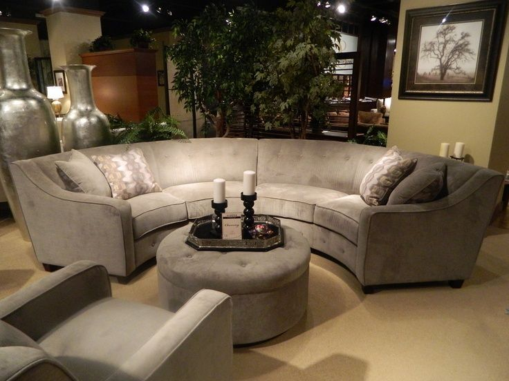 Half circle couch in gray round cushioned center table with a candle centerpiece    #Half #Circle #Couch