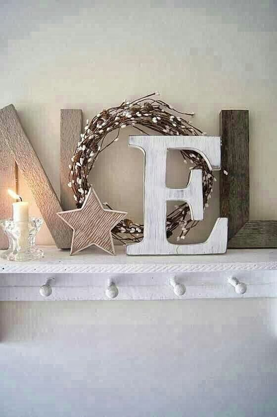 NOEL letters made from rustic wood plus a simple wreath. Love this presentation.: