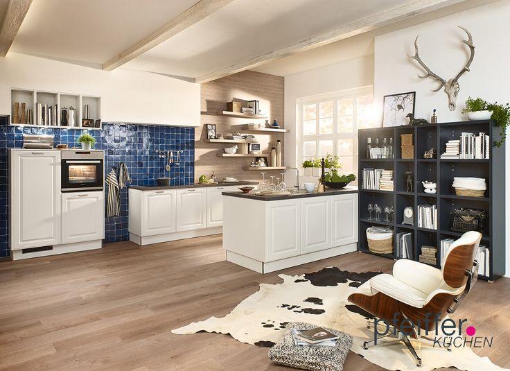 Rustikaler Charme in der Küche - auf technische Raffinessen und Designklassiker muss man hier nicht verzichten.