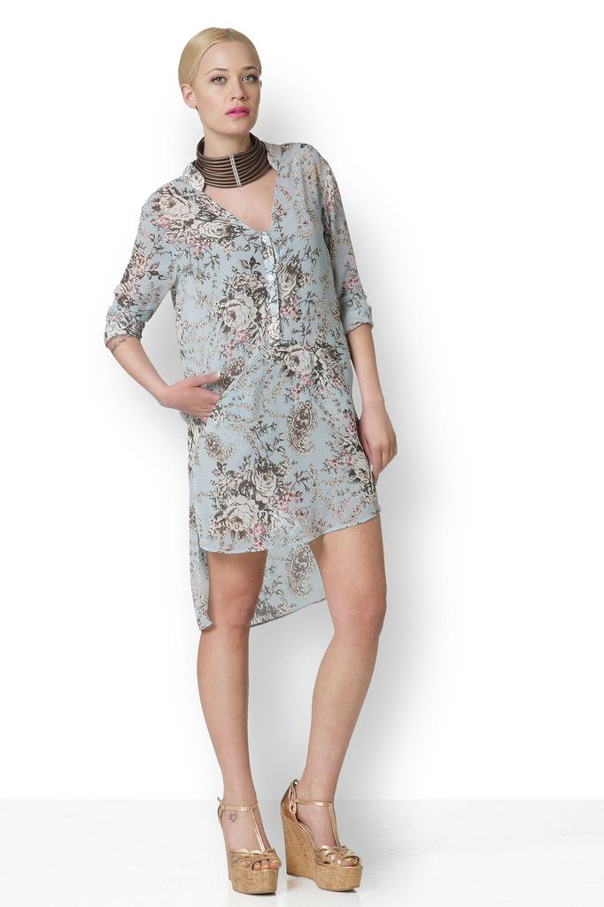 ΦΛΟΡΑΛ ΠΟΥΚΑΜΙΣΟΦΟΡΕΜΑ Φλοράλ πουκαμισοφόρεμα με διαφορετικά μήκη. Τα μήκη του είναι 82 εκατοστά μπροστά και 100 εκατοστά. Έχει τρία κουμπιά μπροστά και δύο μικρές τσέπες.