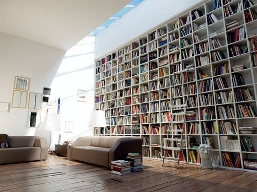 Seriously, I can't get over the effect of wood anything in a white room. The bookcase wall is amazing, and the open roof was a nice touch.