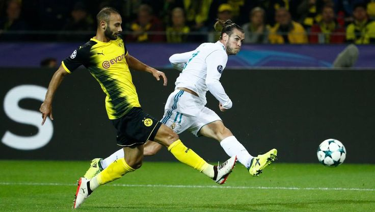 Borussia Dortmund 1-3 Real Madrid: Bale & Ronaldo Silence Yellow Wall in Champions League Classic  To read the full article, visit: