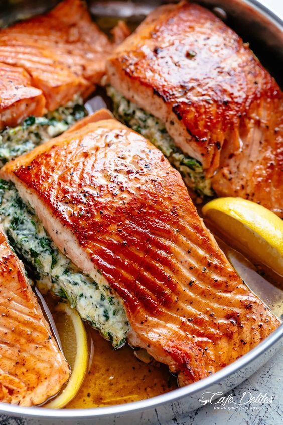 Creamy Spinach Stuffed Salmon in garlic butter is a new delicious way to enjoy s…