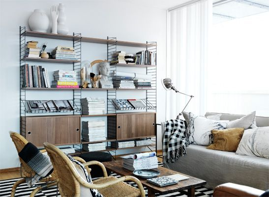 Love the walnut shelves with black metal frame. From www.string.se. Those dastardly swedes again!
