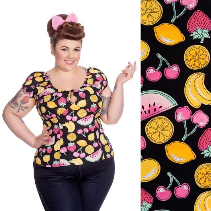 The Carmen top in 'Curve' Size!     Printed top. Print is of lemons, cherries, strawberries, oranges and slices of melon on a black background. Elasticated neck edge. Keyhole shape at the centre front with button and loop to fasten. Elasticated sleeve openings. Seam under the bust for shaping. Pair with our Joanie Pencil skirt for a classic rockabilly look! Fabric content: 98% Cotton 2% Elastane.