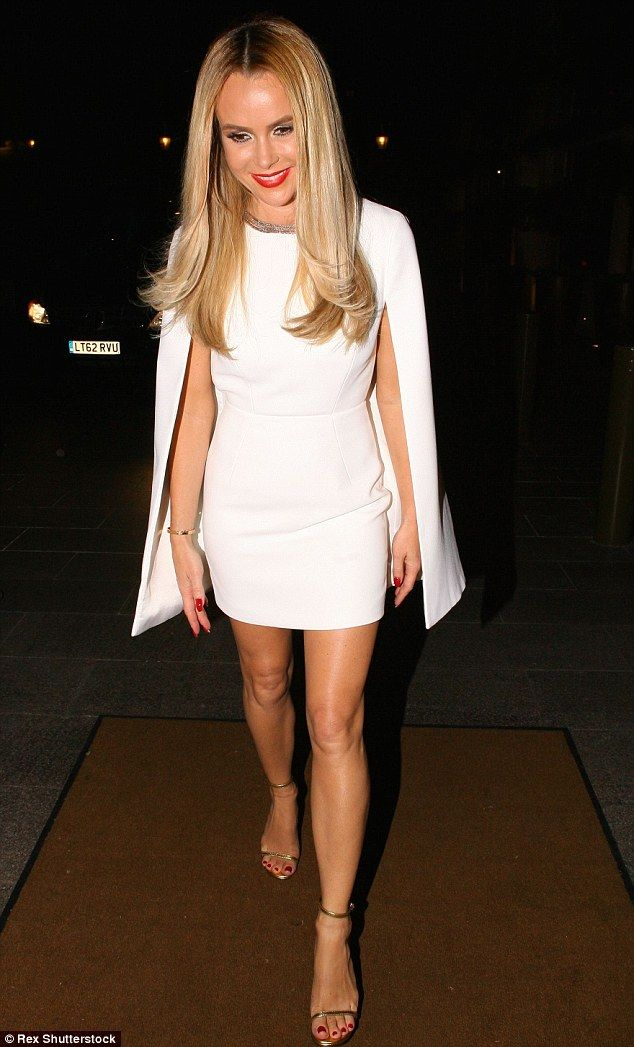 Not so busty now! Amanda Holden decided to rein it in as she headed to the official Britai...