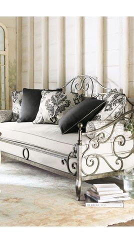 I would like something like this, but with a black iron frame only on the headboard