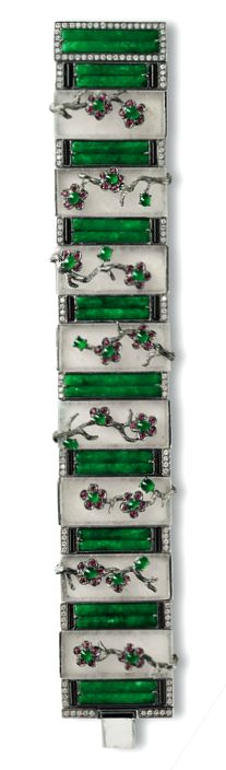 ICY JADEITE, JADEITE, ONYX, RUBY AND DIAMOND BRACELET The bracelet set with alternating curved jadeite plaques of emerald green colour and rectangular icy jadeite plaques, decorated by floral motifs set with circular-cut rubies and jadeite cabochons of translucent emerald green colour, embellished by onyx and circular-cut diamonds, the diamonds together weighing approximately 1.10 carats, mounted in 18 karat blackened gold, length approximately 180mm.
