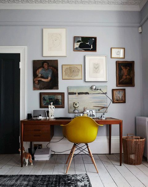mid-century modern home office, contrasted with deep baseboards, painted wood floors, & ceiling details, all in neutrals, gallery wall