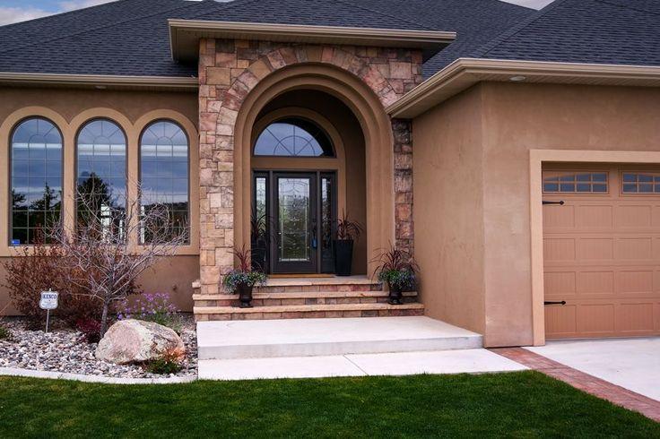 Mediterranean Front Door with exterior stone floors, exterior tile floors