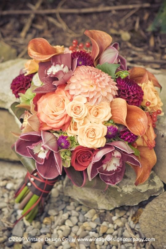 #coral wedding #peach wedding The color palette featured a very seasonal 'Fire' in mainly orange through yellow with hits of chocolate, burgundy, crimson and hues of bluey green. To accomplish the 'look and feel' we were after, we used florals such as orchids, BC hydrangeas, roses, dahlias, pink pepperberries and magnolia leaves. Definitely one of our favorite fall color combinations!
