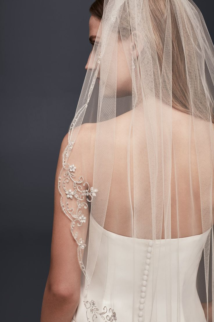 A romantic airy-tulle and embellished wedding veil | Scrolled Scallop-Edge Fingertip Veil from David's Bridal