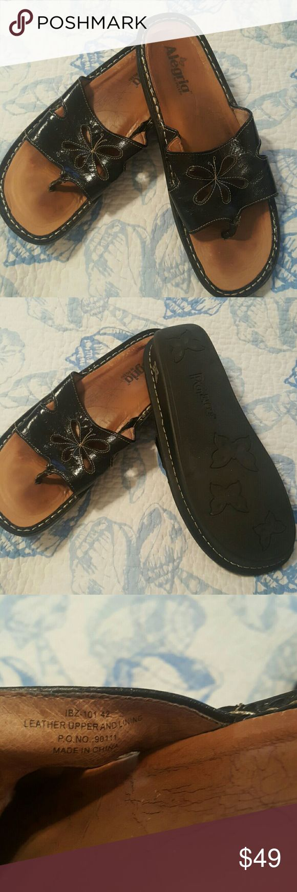 Alegria Black leather sandals These are a pair of Alegria sandals from my non smoking home. In awesome shape. Very little wear shown. So very comfortable. Size 42. I wear a 10 normally. Alegria  Shoes Sandals