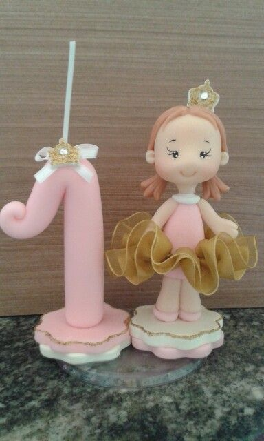 Vela princesa rosa e dourado