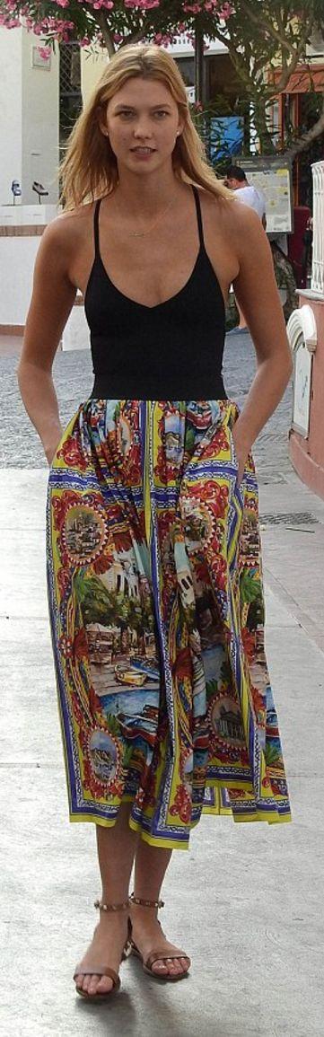 Karlie Kloss: Skirt – Dolce & Gabbana  Shoes – Valentino  Shirt – The Reformation
