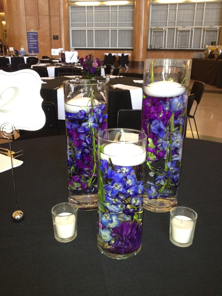 Peacock wedding colors floating candles with blue orchids