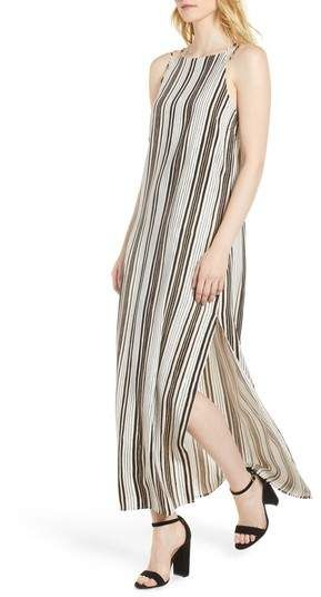 abcc154c2b7 cupcakes and cashmere Corin Stripe Maxi Dress The neckline and side slit  are both cut high on this striped maxi dress that s a perfect combination  of flirty ...
