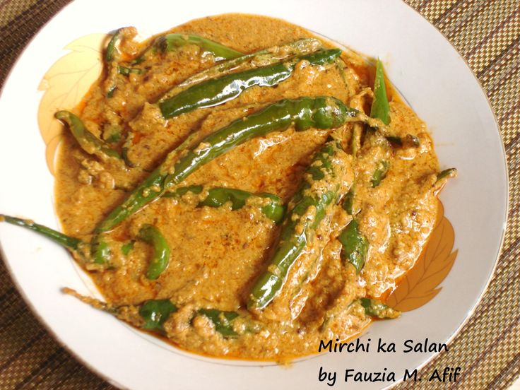 This is another favourite of mine, a popular Hyderabadi dish made of curried large chilli peppers cooked in a nutty thick sauce.I normally use the same technique for the sauce as the one for my bagharay baingan recipe and serve this dish as a pickle or side dish for rice or biryani meals.