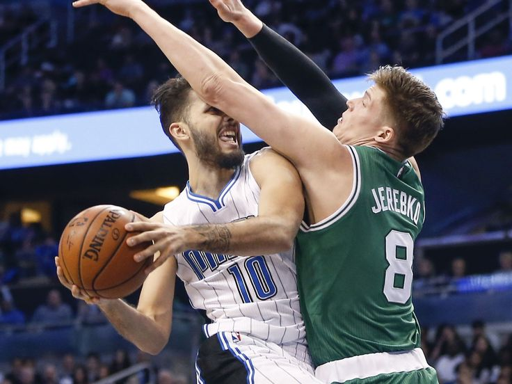 Jan. 31, 2016: Magic guard Evan Fournier (10) drives to the bucket despite an arm in his face from Celtics defender Jonas Jerebko (8) during the second half in Orlando. Fournier scored a team-high 24 points to help the Magic win 119-114.  Reinhold Matay, USA TODAY Sports