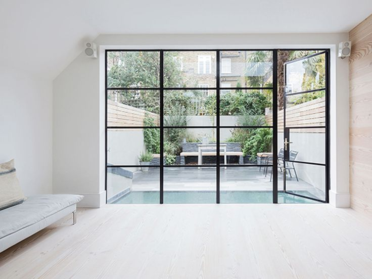 The luminous glass wall opening out onto the outside space #interdema #design  #white #luminousglass #lifestyle