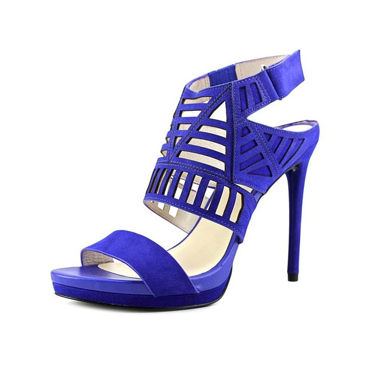 Kenneth Cole New York Women's Niko Cut Out Dress Sandal, Electric Blue, 8 M US. Platform dress sandal featuring geometric cutouts and adjustable hook-and-loop backstrap. Concealed goring at ankle strap.