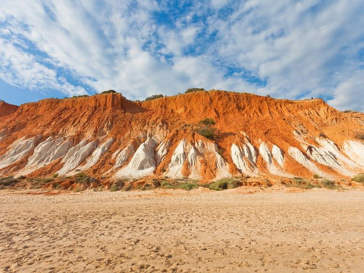 Why we love it: The beach draws its name from the orange-red cliffs that serve as a backdrop to its nearly four-mile stretch of sand.