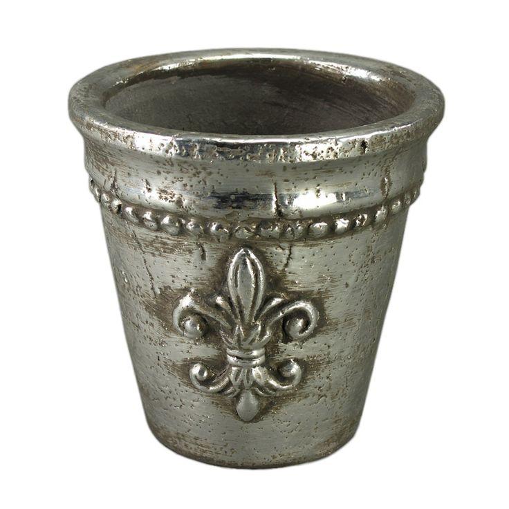 Vă prezentăm un ghiveci deosebit care cu siguranţă vă va trezi interesul: ghiveciul ceramic cu aspect metalic de înălţime 16 cm. Ghiveciul este realizat din ceramică însă datorită finisajului impecabil arată precum o piesă de artă. Având gravat pe el simbolul crinului florentin acest ghiveci arată mai mult ca un pocal bine făurit de pe mesele cavalerilor.