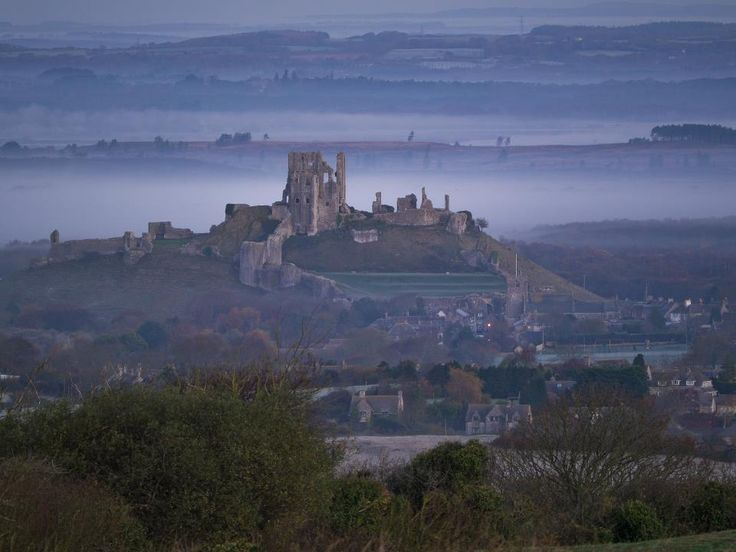 A fantastic view of Corfe Castle in Dorset, England. Built by William the Conqueror, the castle dates back to the 11th century and was demolished on Parliament's orders during the English Civil War.