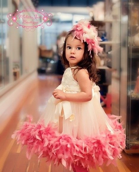 For a flower girl outfit sew a boa to the bottom of a tutu skirt // From Melissa Jane Boutique.