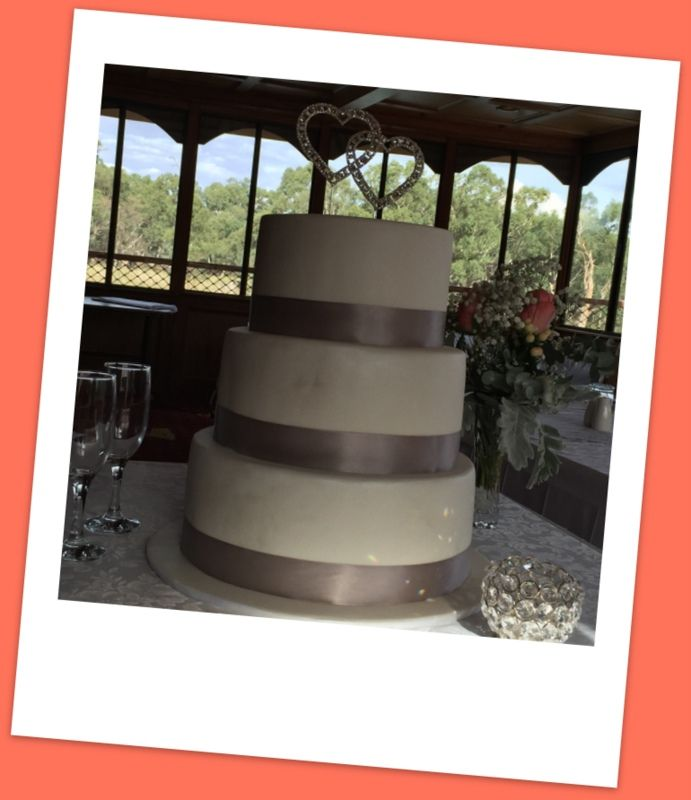 This 3 tier wedding cake is filled with Caramel, Chocolate and White Chocolate mud cake.   Layered with White and dark chocolate ganache