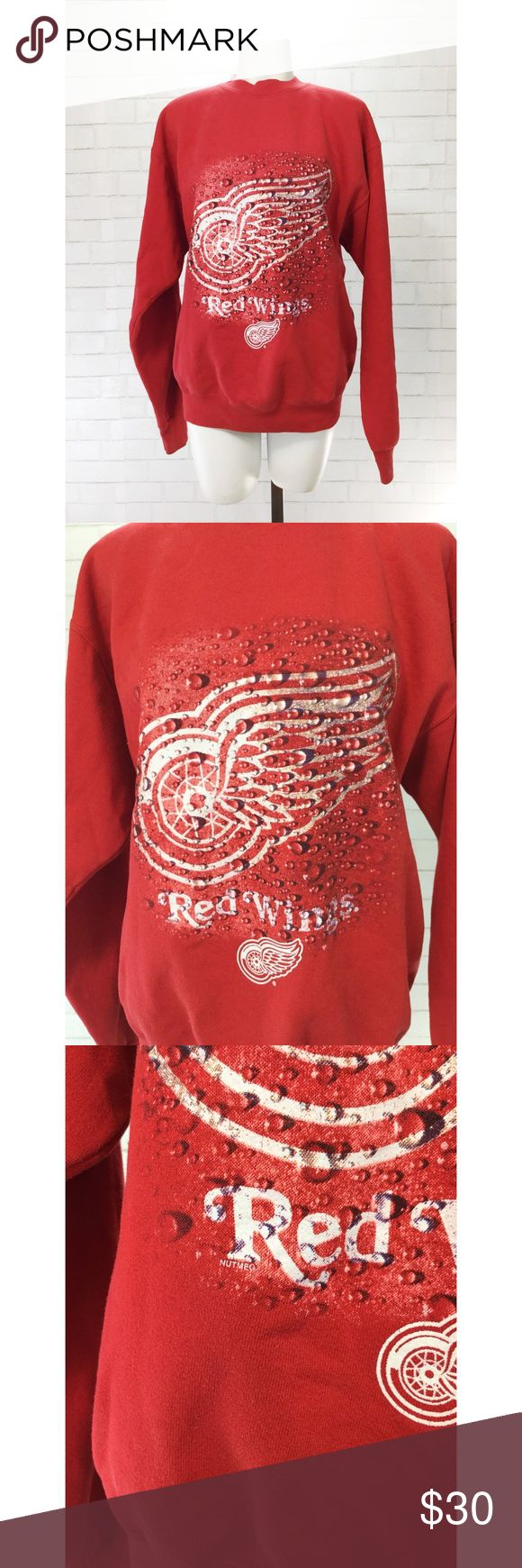 """Vintage 90s Detroit Red Wings NHL Nutmeg Sweatshir Vintage 90s Detroit Red Wings NHL Nutmeg Sweatshirt EUC. Rare Red Wings pullover by nutmeg mills in the 90's. Looks like new. Officially licensed apparel by the NHL. This is a vintage XL which is more like a L today. Cute oversized.   Shoulders = 21"""" Chest = 21"""" Length = 26"""" Sleeve = 24"""" Nutmeg Tops Sweatshirts & Hoodies"""