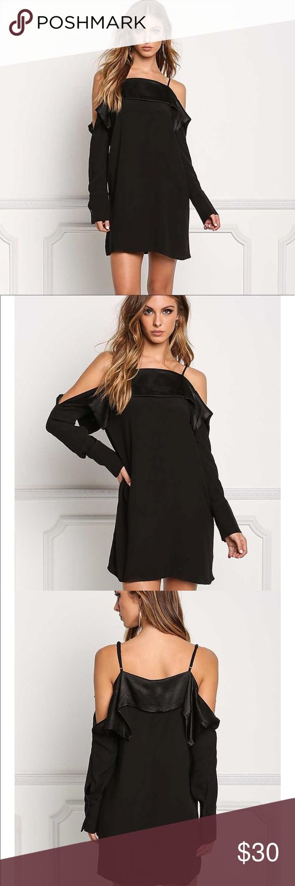 Black cold shoulder layered dress New gorgeous black shift dress , silky interior that peaks out along the short layered top, long sleeve with shoulder cut out spaghetti strap . Super chick  , perfect for a nite out or that special Date ! boutique culture Dresses
