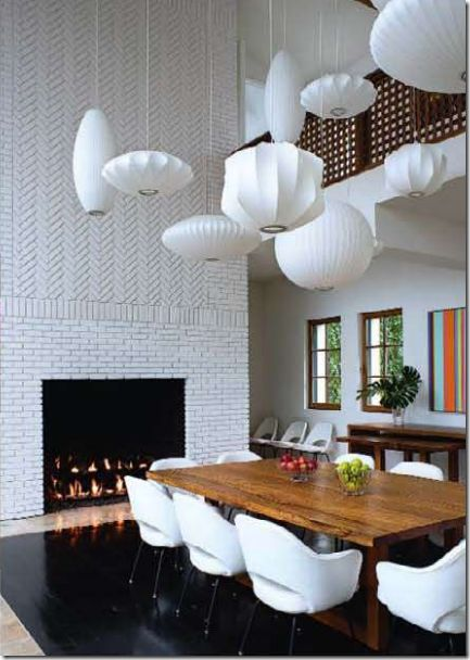 george nelson bubble pendants @no way Saunders. Love it, except the tile around the fireplace. Light fixtures are interesting.