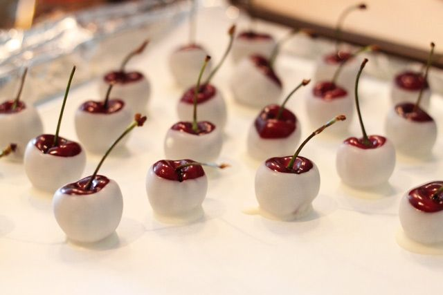 Alcohol Soaked White Chocolate Cherries (Pitted cherries with stems placed in jar of amaretto, bourbon, etc overnight or longer, then dipped. (I am thinking of maybe soaking in Choc Vine.)