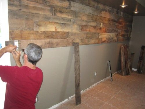 Reclaimed Pallet Wall. Good how-to info here could add a little insulated warmth in the winter...