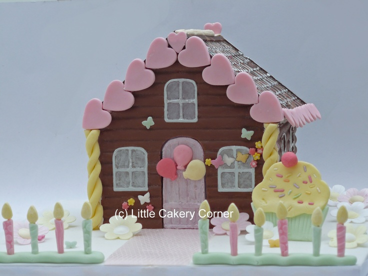 A stunning Happy Birthday chocolate house for any little girl - or lady partial to a bit of choccie!  In lovely pastel shades of pink, lemon yellow and mint green - this is a beautiful alternative to cake.  This idea would also work well for a house warming or other occasion.