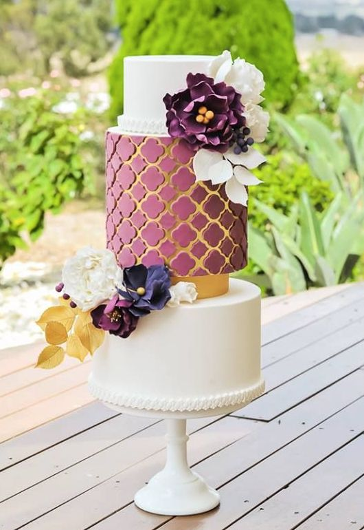 "purple floral wedding cake; - click to see more ""The Most Sensational Floral Wedding Cakes"" - Featured Cake: Kiss My Cakes"