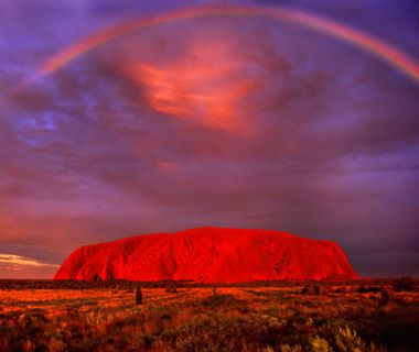 Ayers Rock, Northern Territory, Australia Turning your back on a sunset may seem counterintuitive, but Uluru—the massive red-rock monolith that looms above Australia's stark northern desert—always upstages the sun. The best vantage point, according to local photographer Steve Strike, is Sunset Strip, a picnic area in Uluru-Kata Tjuta National Park.